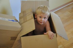 child in a moving box