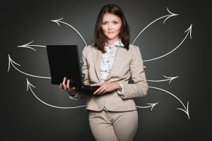 A woman ready to present a moving plan for a business.