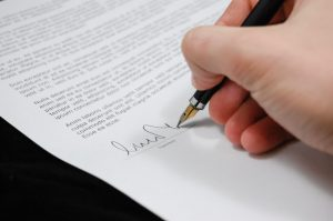 Hand signing a paper