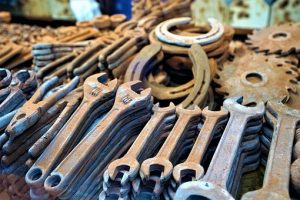 Rusty wrenches on the table used for building a man cave