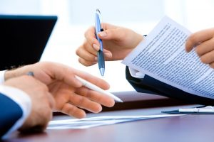 A contract being signed - it's time to affordably relocate your business.