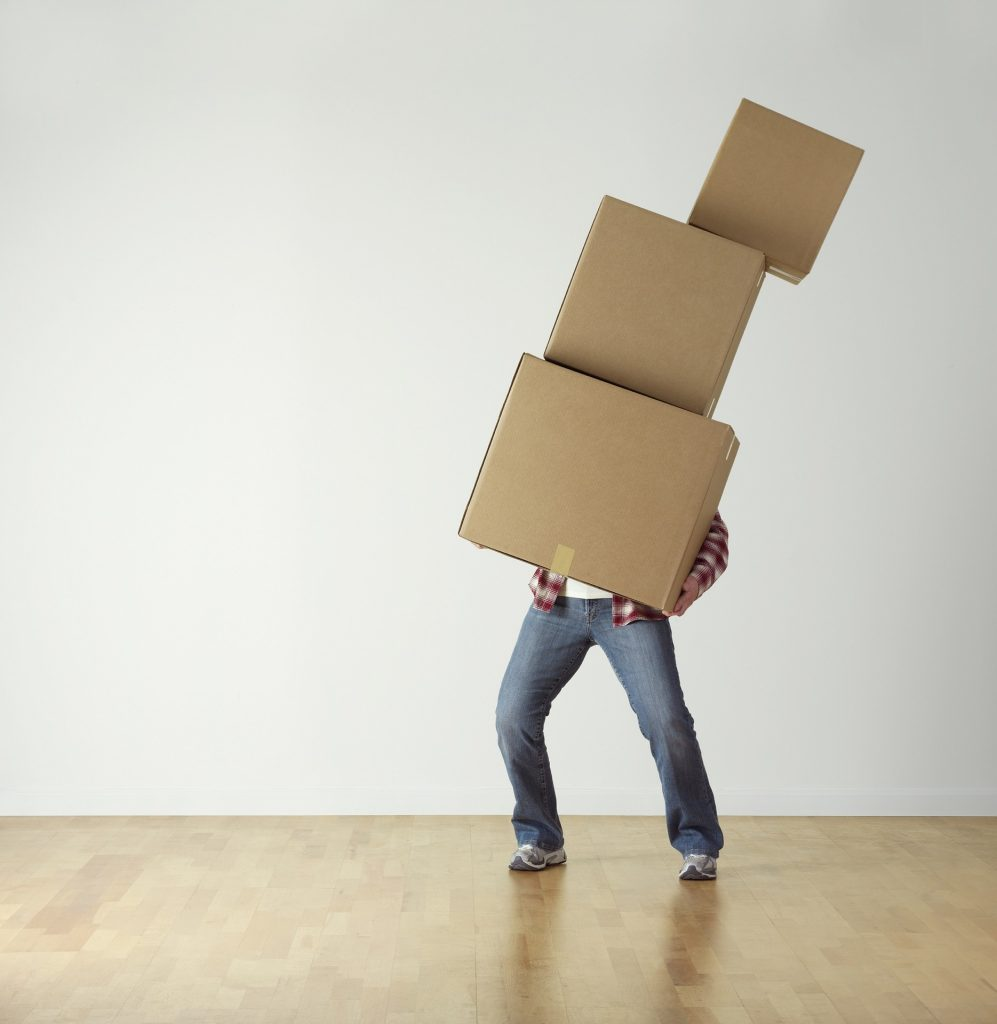 A man carrying moving boxes - the moving supplies you will definitely need.
