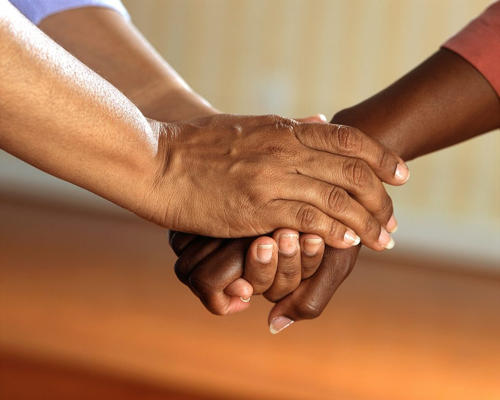People clasping hands.