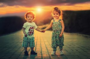 Two kids holding hands.