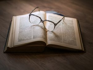A book and glasses.