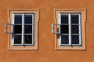 Windows on an orange wall.