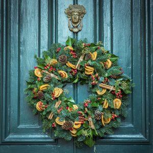 Green wreath on blue doors