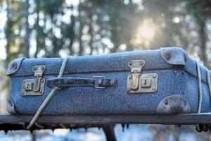 A close up of a blue suitcase