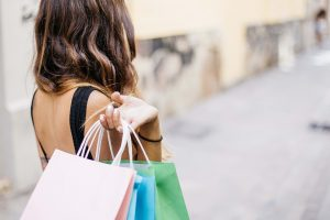 A woman holding shopping bags.