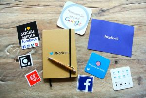 Social media written on notebook and papers.