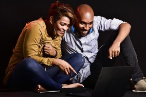 Woman and a man looking at laptop