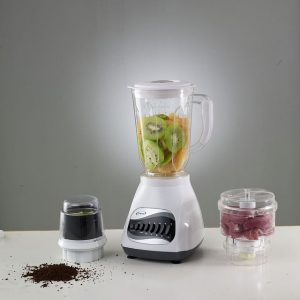 Blender with fruits and spices.
