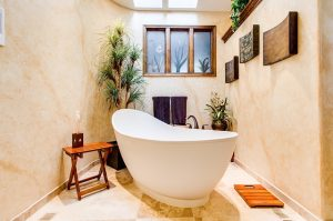 Beautiful bathroom with a bath tub and plants add value to your home