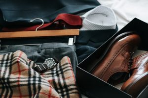pack belongings for winter storage, such as a suit, watch and shoes