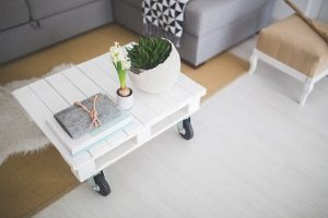 Table with notebook and plants can add value to your home