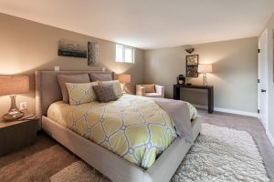 Bedroom with king size bed, table and lamp