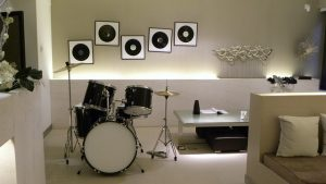 Renovate your basement and turn it into music room, with drums and table