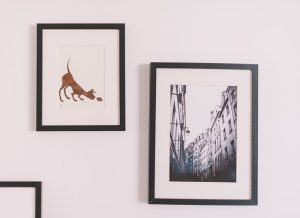 ack and move picture frames with pictures of dog an buildings