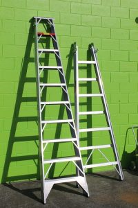Ladder by the green wall