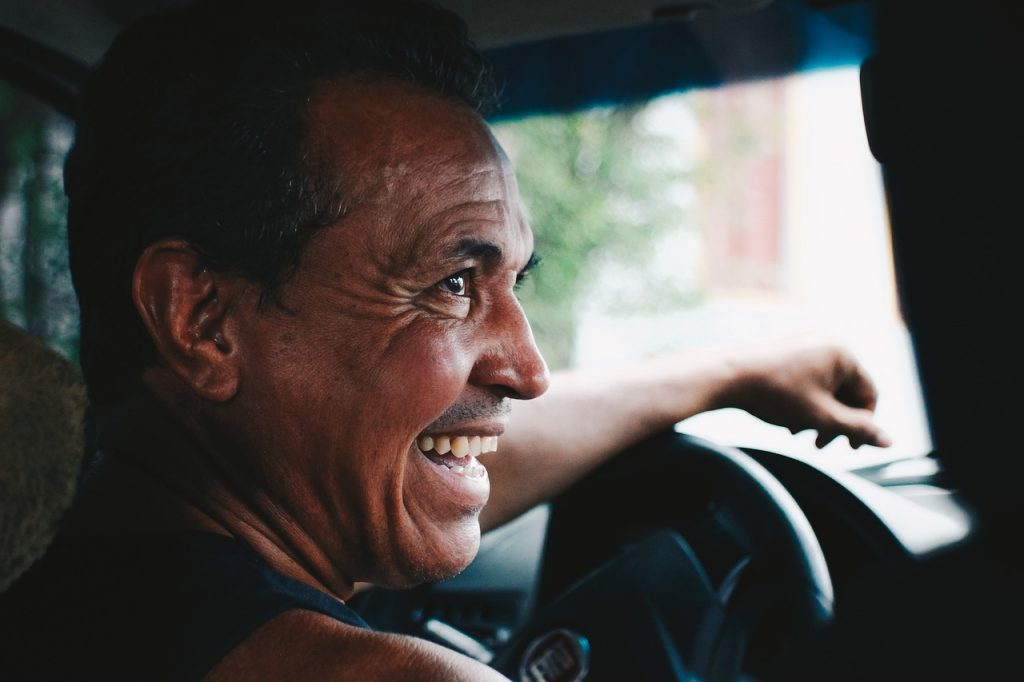 A man behind the wheel smiling