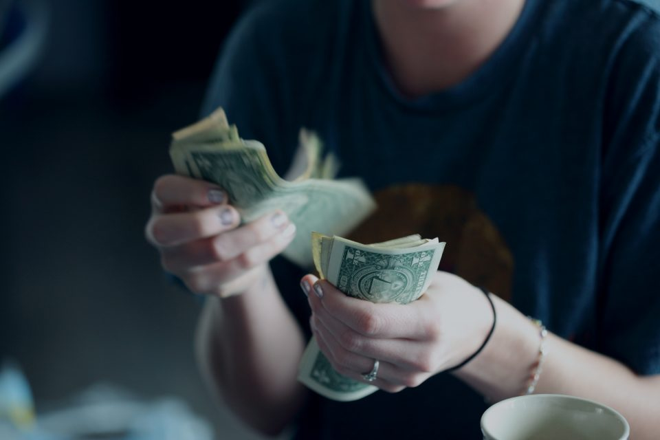 Hands counting dollar bills