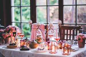 Table with food, plates, flowers and candles