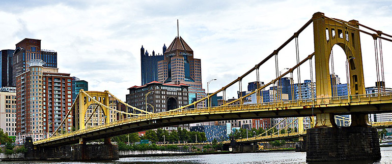 a yellow Pittsburgh bridge