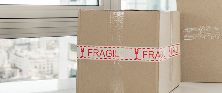 cardboard boxes labelled as fragile