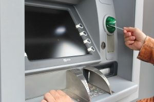 person using ATm that they found Week Before You Move