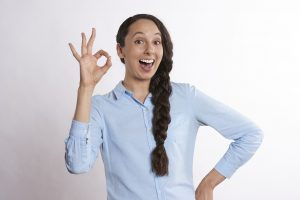 a woman showing hand sign for okay