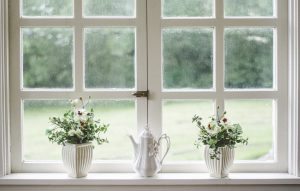 Replace a window, and paint it white, decorate with flowers