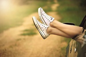summertime relocation guide helps a woman to relax and lift her feet up