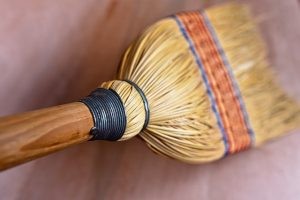 Use a broom to sweep the floors on the first day in your new home.