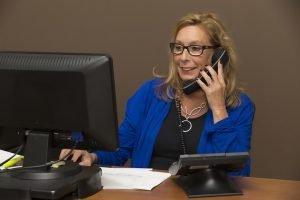 secretary on the phone talking